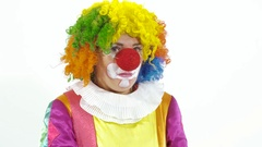 Mysterious and funny clown pretends he hears something Stock Footage