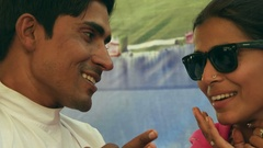 Beautiful Indian woman wearing sunglasses and pink sari with her man in red turb Stock Footage
