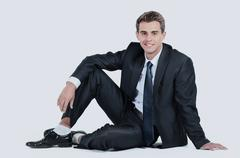 Business man sitting isolated on a white background Stock Photos