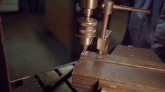 Close-up of industrial worker drilling a hole in a metal bar Stock Footage