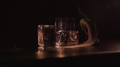 Brilliant ice and colorful streams of smoke Stock Footage