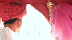Close up of romanic beautiful couple enjoying a camel ride at a mela festival ca Stock Footage