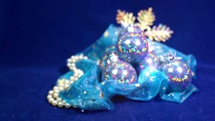 New Year's balls and ribbon on a blue background Stock Footage