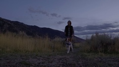 Slow Motion Shot Of Man Walking His Dog On Nature Trail In Utah Stock Footage