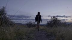 Tracking Shot Of Young Man Walking His Dog Through Trail In Utah (Slow Motion) Stock Footage