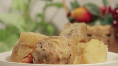 Chicken legs with potato served on the white plate Stock Footage