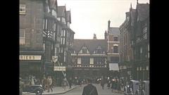 Vintage 16mm film, 1952, England Shrewsbury city #2 people and traffic Stock Footage