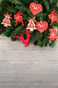 Holiday decorations. Christmas tree with red hurts and funny deers on it. White Stock Photos