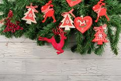 New Year decorations. Christmas tree with red hurts and funny deers on it. White Stock Photos