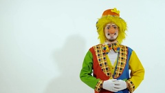 Smiling colorful clown showing the good way to go Stock Footage