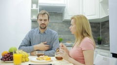 Young couple in the kitchen. drinking tea and eating fruit Stock Footage