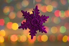 Christmas decorations. Close up photo of New Year purple snowflake. Nice toy in Stock Photos