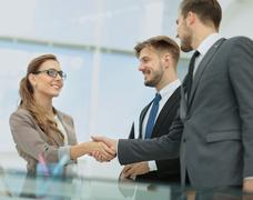 Business woman shaking hand to  her  partner Stock Photos