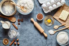 Dough preparation recipe ingridients flat lay on kitchen table background Stock Photos