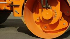 Under Pressure Asphalt Paving during Road Construction Works Stock Footage