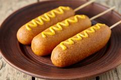 American corn dog street junk food deep fried hotdog meat sausage snack with Stock Photos