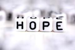 Hope word made from plastic alphabet blocks, stands in white background. Stock Photos