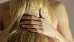 Part view of a man's hands caressing a woman's bare back. Stock Footage