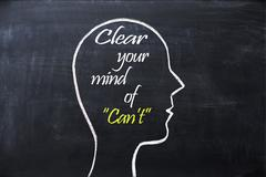 Clear your mind of can't phrase inside human head shape drawn on chalkboard Stock Photos