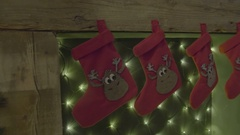 Stockings hanging on a fireplace on christmas eve Stock Footage