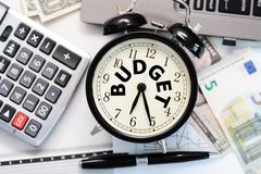 Budget exercise or forecast with old clock concept Stock Photos