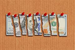 US Dollar bill cut in pieces suggesting weak economy Stock Photos