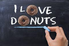 """""""I love donuts"""" concept with tasty chocolate donut on dark background Stock Photos"""
