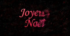"""Merry Christmas text in French """"Joyeux Noel"""" formed from dust and turns to dust Stock Footage"""