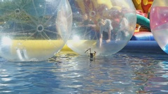 Large inflatable balls floating in swimming pool Stock Footage