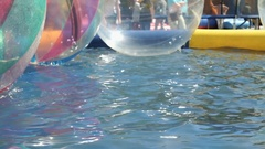 Little boy flounders inside large inflatable ball Stock Footage