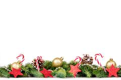 Christmas Border - tree branches with golden balls, candy and decoration Stock Photos
