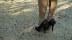 Female legs . Women Running In High Heels Stock Footage