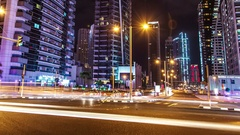 Dubai crossroads at night. Zoom out.Time lapse. Stock Footage