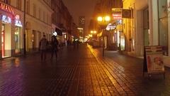 WARSAW, POLAND - NOVEMBER, 28, 2016. Old town street at snowy night. European Stock Footage