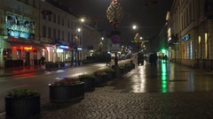 WARSAW, POLAND - NOVEMBER, 28, 2016. Christmas decorated street in the evening Stock Footage