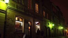 WARSAW, POLAND - NOVEMBER, 28, 2016. Old town street at night. European city 4K Arkistovideo