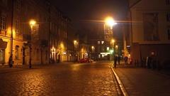 WARSAW, POLAND - NOVEMBER, 28, 2016. Cozy old town street at night. European Stock Footage
