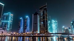 Dubai Marina with high traffic at night. Time lapse.Zoom in. Stock Footage