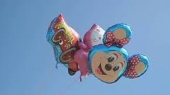 Balloon in the shape of mickey mouse in the sky Stock Footage