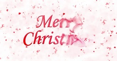 Merry Christmas text formed from dust and turns to dust horizontally on white Stock Footage