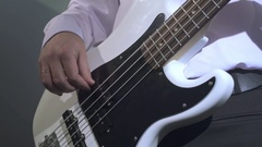 Bottom view of guitarist playing on his instrument Stock Footage
