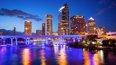 Downtown Tampa, Florida City Skyline at Night - Cityscape (logos blurred) Stock Photos