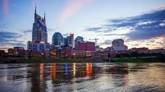 Nashville, Tennessee Cityscape Skyline Across The Cumberland River (logos b.. Stock Photos
