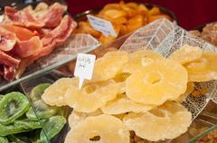 Sliced dried ananas  at the christmas market. Stock Photos