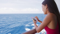 Smart phone close up - woman using smartphone app on cruise ship vacation travel Stock Footage