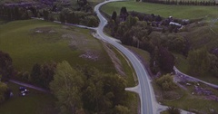 Aerial of car driving on countryside road, south island near queenstown Stock Footage
