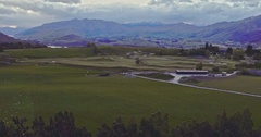 Aerial of countryside, sheep farm and near queenstown, south island Stock Footage