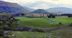 Aerial of countryside road, farm and hills in the south island near queenstown Stock Footage