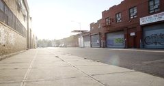 An establishing shot of an industrial Brooklyn Block at sunset - 4k Stock Footage