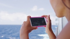 Cruise ship vacation girl taking photo with phone Stock Footage
